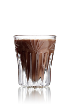 shooter drink: Cappuccinotini alcoholic cocktail in faceted shot glass (shooter) Stock Photo