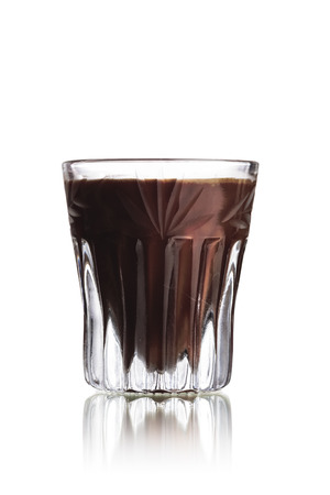 shooter drink: Black Russian alcoholic cocktail in faceted shot glass (shooter)