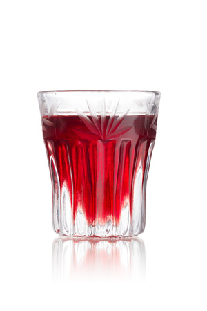 shooter drink: Woo Woo alcoholic cocktail in faceted shot glass (shooter) Stock Photo