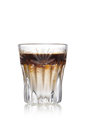 shooter drink: Coffee liqueur alcholic cocktail in faceted shot glass