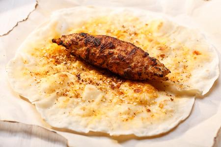 naan: Shish kofte (kofta kebab) on naan spiced flatbread Stock Photo