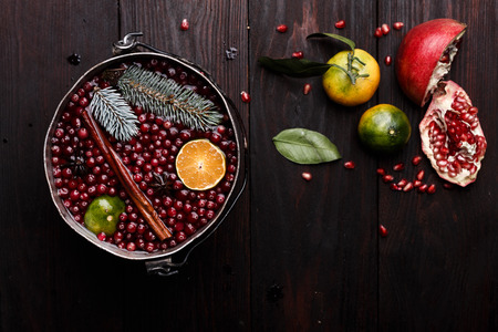 burnished: Cranberry mandarin pomegranate punch or mulled wine in a rustic aged pot