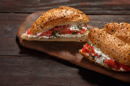 brea: Sandwich from wholegrain bread with salmon, mild creamy cheese and herbs Stock Photo