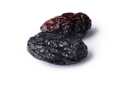 untreated: Dark natural seedless raisin from California. Sun-dried untreated grape. Retouched, large depth of field