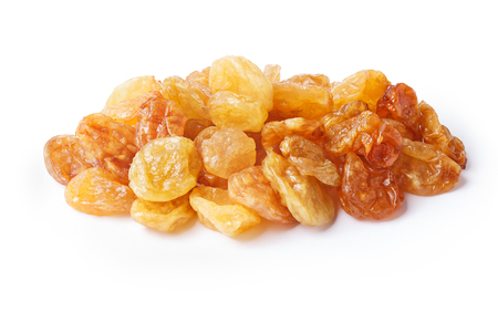 seedless: Golden natural seedless raisins from California. Dried treated grapes. Retouched, large depth of field