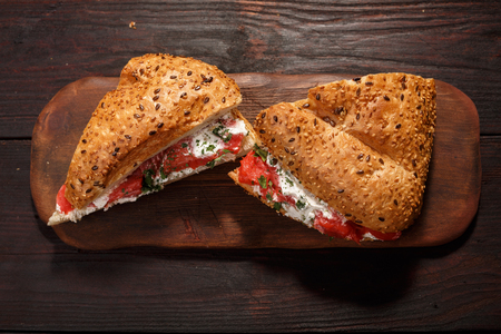 Sandwich from wholegrain bread with salmon, mild creamy cheese and herbs Stock Photo
