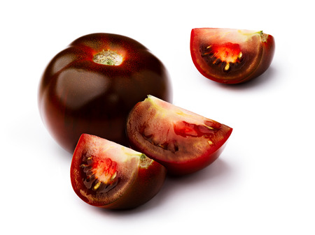 burnished: Dark red, green, black, brown tomato isolated on white, whole and chopped. Retouched, infinite depth of field Stock Photo