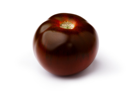 burnished: Dark red, green, black, brown tomato isolated on white. Retouched, infinite depth of field