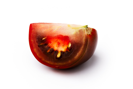 burnished: Dark red, green, black, brown tomato slice isolated on white. Retouched, infinite depth of field