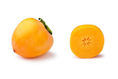 diospyros: Whole and half Hachiya persimmons (fruit of Diospyros kaki) isolated on white. Matt, scuffed appearance, infinite depth of field