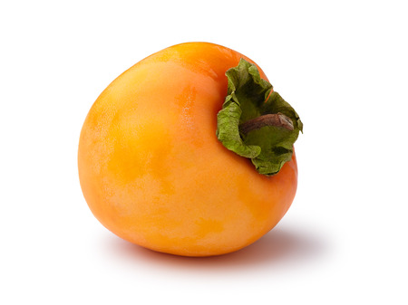 scuffed: Whole Hachiya persimmon (fruit of Diospyros kaki) isolated on white. Matt, scuffed appearance, infinite depth of field Stock Photo