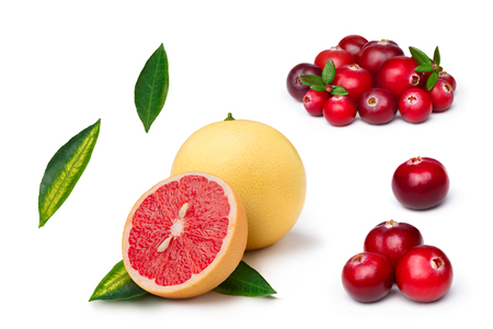 florida citrus: Set of cranberries, whole and sliced pink grapefruit isolated on white. Exploded view. Large depth of field