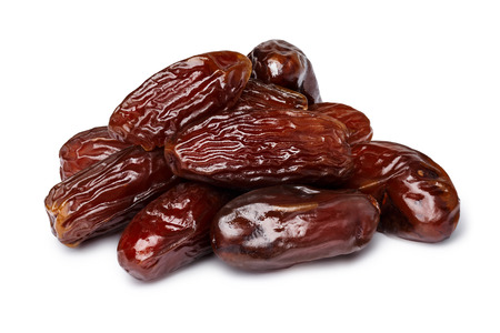 Dried dates (fruits of date palm Phoenix dactylifera).  Clipping paths for both objectsa and its shadows. Infinite depth of field, retouched.