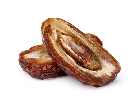Dried split date (fruit of palm Phoenix dactylifera). Infinite depth of field, retouched, clipping paths
