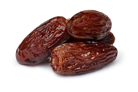 Dried dates (fruits of date palm Phoenix dactylifera). Infinite depth of field, retouched, clipping paths
