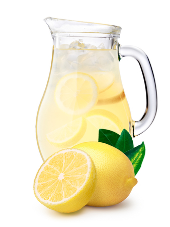 Jug or pitcher of iced lemonade or citronade with lemons on foreground. Clipping paths, large DOF
