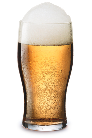 pilsner glass: Moist glass of cold, frothy light beer with foam. Separate clipping paths for both glass and shadow, infinite depth of field Stock Photo
