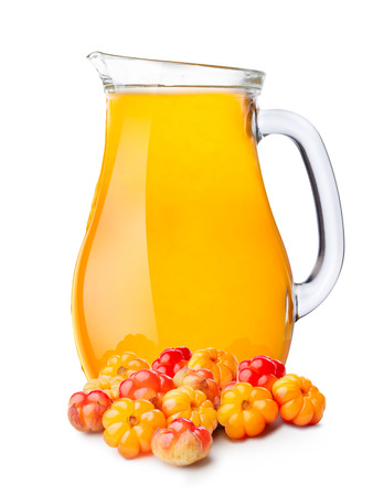 chicout�: Cloudberry smoothie pitcher or jug with cloudberries on foreground. Banque d'images