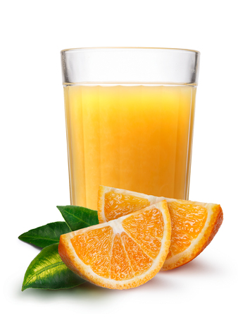 highball: Faceted glass (highball) with orange juice with orange slices on foreground.