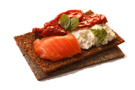 sun dried: Bread crisp (crispbread open-faced sandwich) with salmon, soft cream cheese, sun dried tomatoes and fresh chervil.