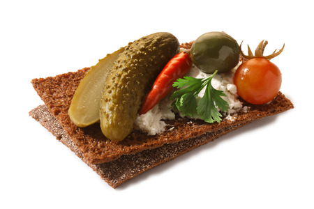 vegetarian hamburger: Bread crisp (crispbread open-faced sandwich) with pickled vegetables , soft cream cheese and cilantro leaves. Clipping paths for both crisp and shadow, infinite depth of field