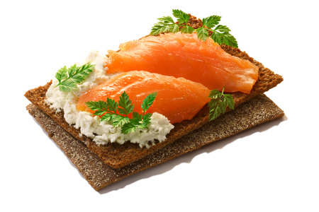 Bread crisp (crispbread open-faced sandwich) with salmon, soft cream cheese and fresh chervil. Zdjęcie Seryjne