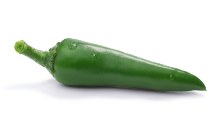 Single green chili pepper (Capsicum Annuum) with few droplets. Clipping paths, shadow separated, infinite depth of field
