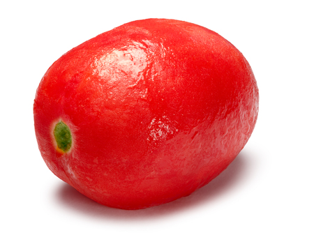Whole peeled, oiled tomato. Clipping paths, shadow separated, infinite depth of field