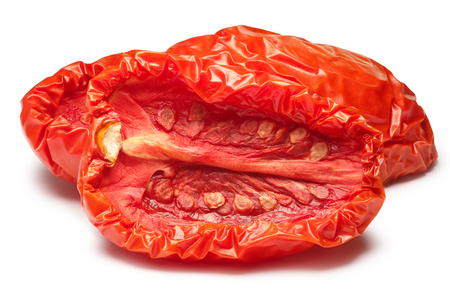 Sun dried tomatoes halved, medium residual moisture content, with seeds.  shadow separated, infinite depth of field. Design element Stock Photo
