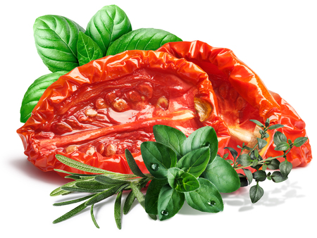 oiled: Sun dried tomatoes,oiled, with fresh herbs. shadow separated, infinite depth of field. Design element Stock Photo