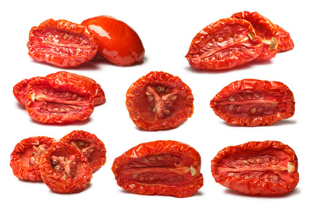 oiled: Sun of plain and oiled dried tomatoes, medium residual moisture content, with seeds. Clipping paths, shadows separated, infinite depth of field. Design elements Stock Photo
