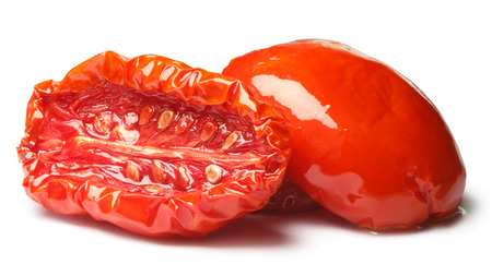 residual: Sun dried tomato halves, oiled, medium residual moisture content, with seeds. Stock Photo