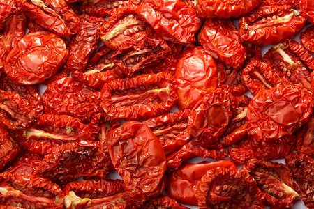 sun dried: Sun dried tomatoes background. Loose layout. Infinite depth of field, top view