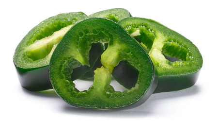 Pile of green Jalapeno pepper slices, crosswise, seeds removed. Clipping paths, shadow separated. Design elements