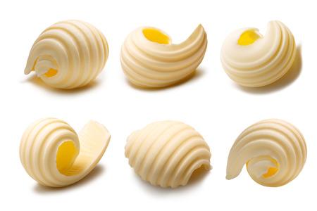 Set van verschillende boter krullen of rollen. Clipping paths, schaduwen gescheiden Stockfoto