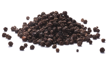 piperine: Pile of black peppercorns (dried seeds of Piper nigrum). Clipping paths, shadows separated