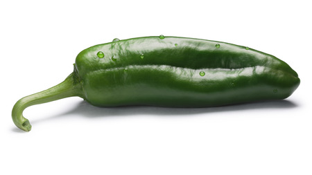 Green whole Anaheim pepper (Capsicum annuum), the mild variety of New Mexico (Numex) chile No. 9. Clipping paths, shadow separated Stock Photo