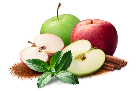 Mint, whole and halved red and green apples next to piles of cinnamon, in sticks and ground. Clipping paths, shadow separated