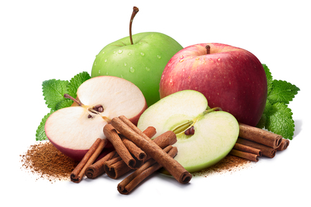 Melissa (Mint balm), whole and halved red and green apples next to piles of cinnamon, in sticks and ground. Clipping paths, shadow separated