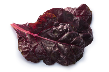Leaves of ruby Swiss chard or Mangold (Beta vulgaris subsp. Cicla-Group). Clipping paths, shadows separated, top view, focus on foreground leaf