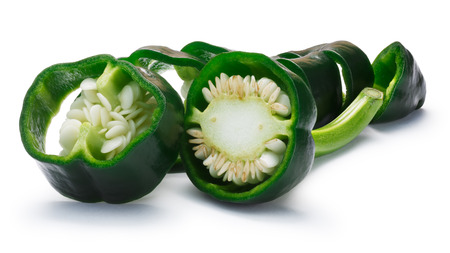 Immature chopped Poblano pepper (Capsicum Annuum), also called Ancho when ripe. New Mexico (Numex) chile. Clipping paths, shadow separated Stock Photo