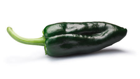 Immature whole Poblano pepper (Capsicum annuum), also called Ancho when ripe. New Mexico (Numex) chile. Clipping paths, shadow separated