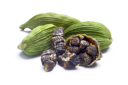 cardamum: Whole green Cardamom, cardamon or cardamum (dried fruits of Elettaria cardamomum) with halved pod and seeds. Clipping paths, shadow separated