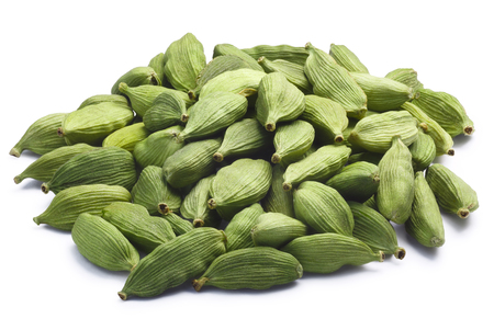 cardamum: Pile of green Cardamom, cardamon or cardamum (dried fruits of Elettaria cardamomum). Clipping paths, shadow separated
