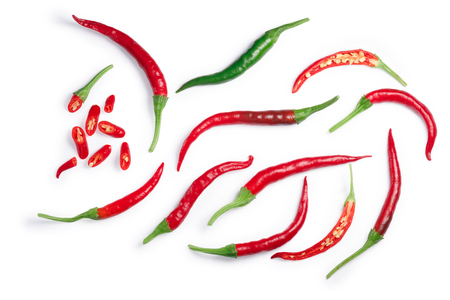 De Arbol chile peppers (Capsicum annuum), ripe, unripe, whole and sliced. Clipping paths, shadows separated, top view