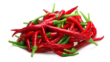 Pile of De Arbol chile peppers (Capsicum annuum), red ripe. Clipping paths, shadow separated