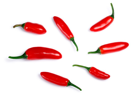 Serrano Tampiqueno chile peppers (Capsicum annuum), red ripe. Clipping paths, shadow separated, top view Stock Photo
