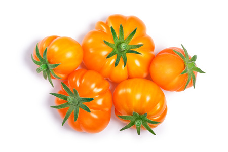 Yellow ribbed heirloom tomatoes (Solanum lycopersicum var. Togorific). Clipping paths, shadows separated, top view