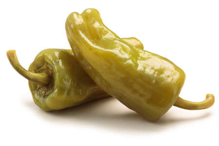 Pickled golden greek peppers, pepperoncini or friggitelli (Tuscan, Stavros, Capsicum annuum). Clipping paths, shadow separated Фото со стока