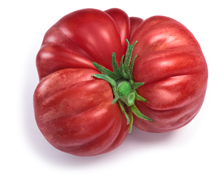 Pink ribbed heirloom tomato, imperfect, irregular shaped, with sepal. Clipping paths, shadow separated, top view